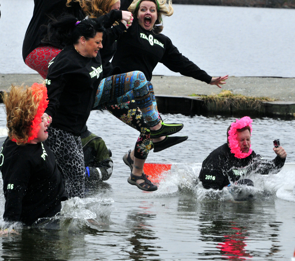 Warm hearts take cold plunge in Winthrop for Special Olympics - Portland  Press Herald 2daa75a8a