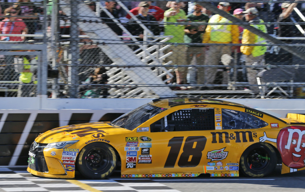 Kyle Busch crosses the finish line to win Sunday's Sprint Cup race at Martinsville Speedway. Busch led 352 of 500 laps on the way to his 35th career Sprint Cup victory.
