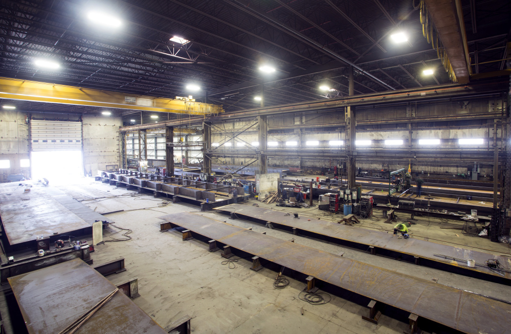 Workers at Casco Bay Steel Structures work on the deck for the Sarah Long Bridge in Portsmouth, N.H.