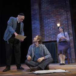 Asher Lev's (Noah Averbach-Katz) parents (Patricia Buckley and Joel Leffert) question his devotion to their faith in My Name is Asher Lev by Aaron Posner, adapted from the best-selling novel by Chaim Potok at Portland Stage.
