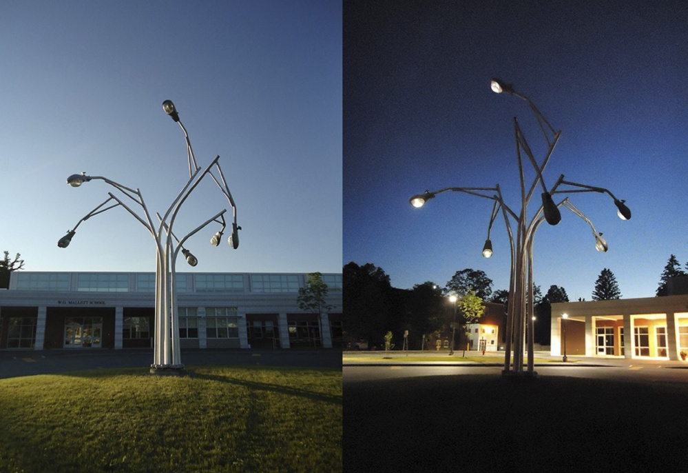 Aaron Stephan was commissioned to build this street lamp sculpture for the W.G. Mallett School in Farmington.