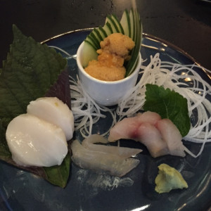 Thomas Takashi Cooke's sashimi plate, with day boat scallops, kombu-cured flounder, seared Spanish mackerel and local Maine sea urchin roe, served at a pop-up dinner at Bao Bao Dumpling House last week.