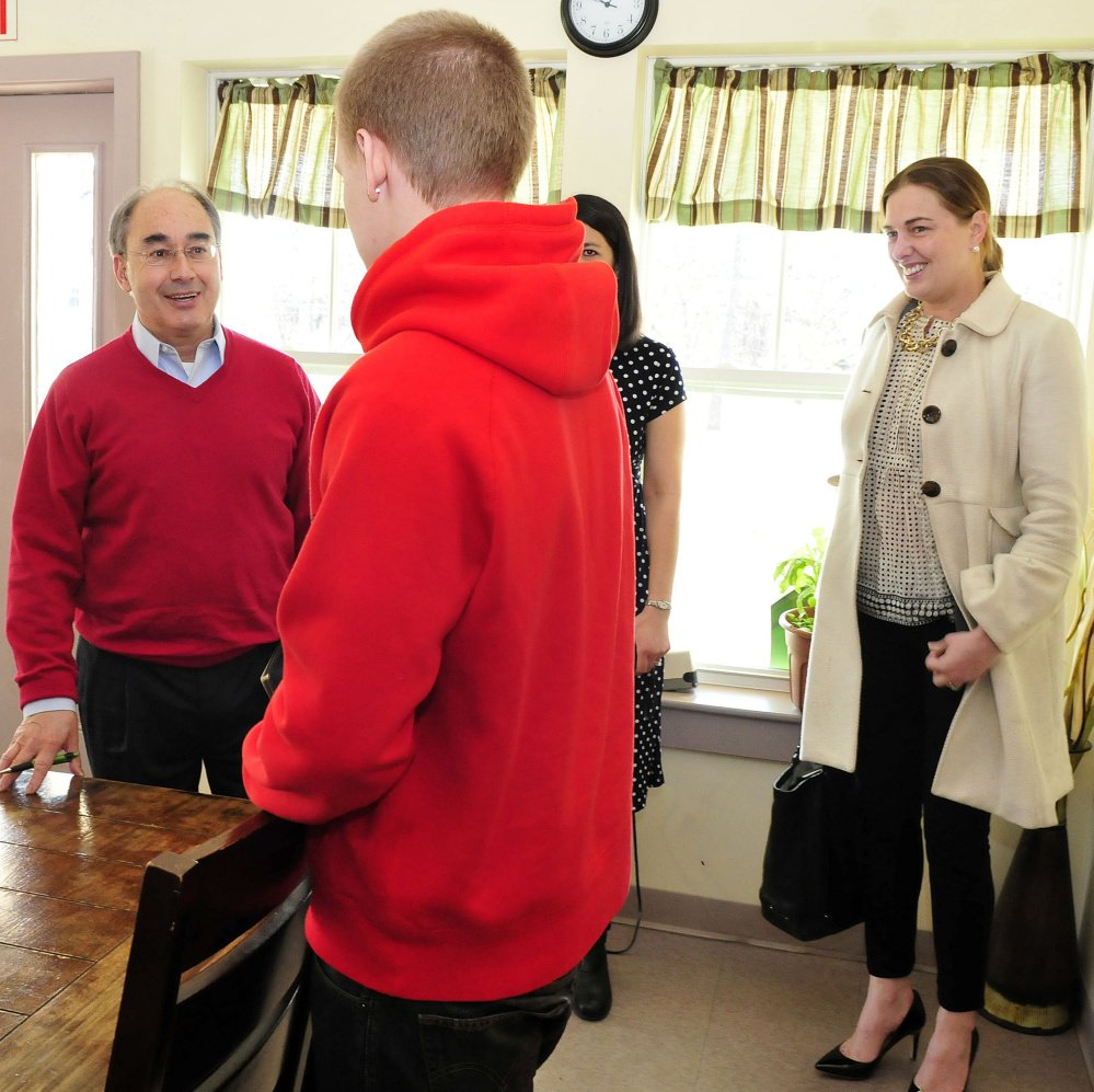 U.S. Representative Bruce Poliquin, R-2nd District, is greeted by student Kyle Hendrickson on Tuesday during a tour of the Day One residential substance abuse center in Fairfield. At right is board member Samantha Warren.