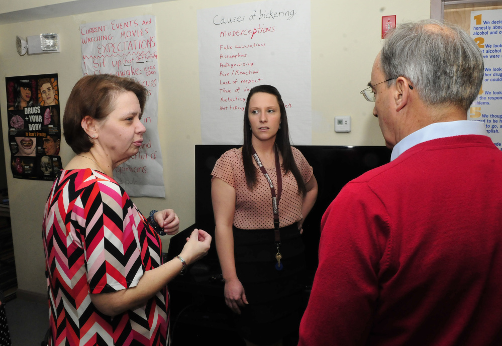 U.S. Rep. Bruce Poliquin, R-2nd District, speaks with staff members Tracy Morin, left, and Megan Nickerson on Tuesday during a tour of the Day One residential substance abuse center on the Good Will-Hinckley campus in Fairfield.