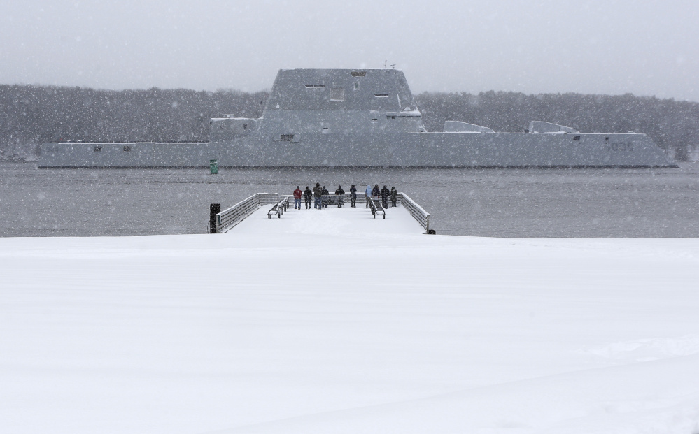 Costs for the Zumwalt-class destroyers are running about 3.7 percent, or $450 million, above estimates from the last fiscal year. Overruns are typical for the first ship in a new class, experts say. Here, the USS Zumwalt, the first in the class, makes it way down the Kennebec River as it heads out for sea trials in March.