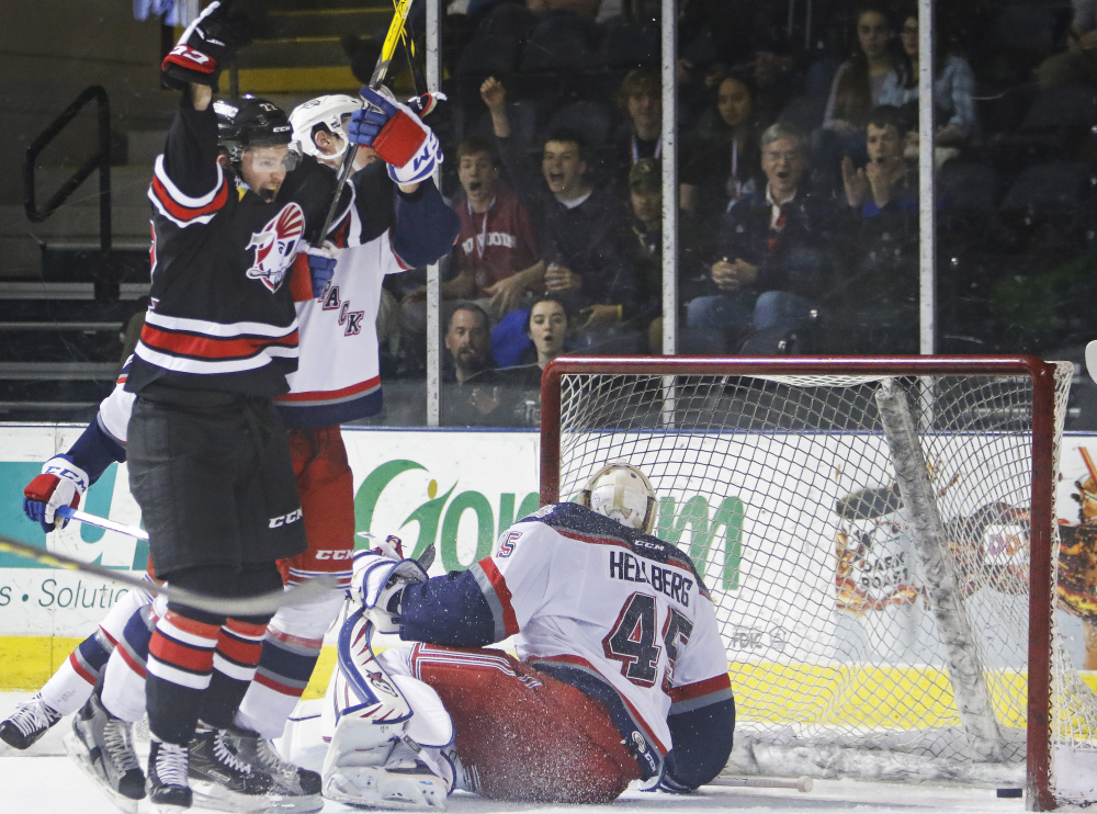 Logan Shaw celebrates one of his two goals Sunday during the Pirates' 3-2 win over the Hartford Wolf Pack at Cross Insurance Arena.