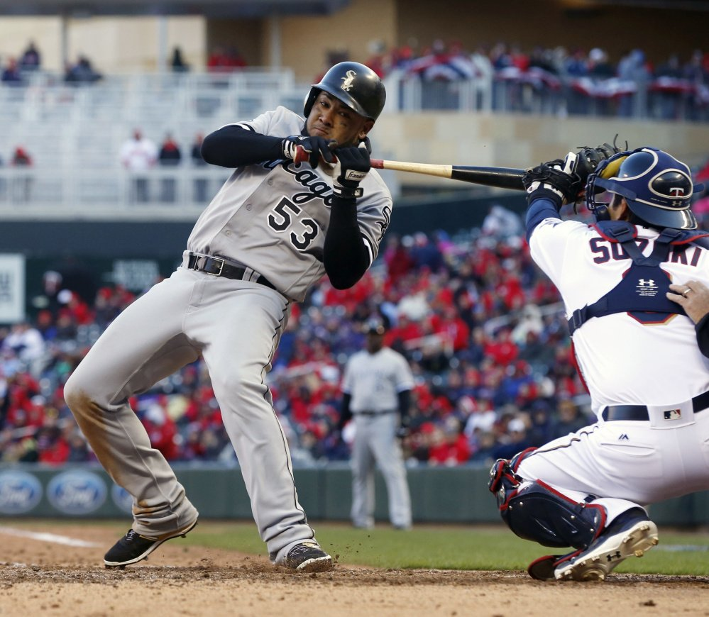 Melky Cabrera of the Chicago White Sox ducks back from a high and tight pitch by Minnesota's Trevor May in the ninth inning of a 4-1 win by the White Sox Monday at Minneapolis. Chicago has opened the season with five wins in seven games.