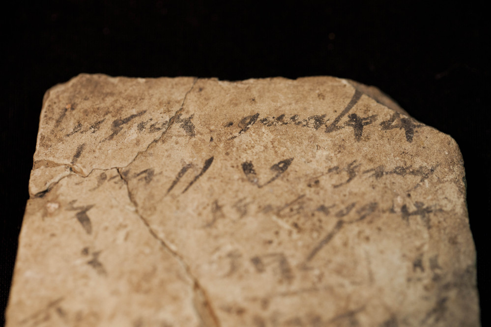 Letters inscribed on pottery, known as ostracons, which were unearthed in an excavation of a fort in Arad, Israel, and dated to about 600 B.C. shortly before Nebuchadnezzar's destruction of Jerusalem, are seen in Israel Museum in Jerusalem Tuesday.