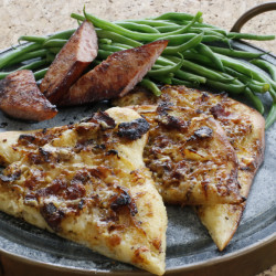 Alsatian onion pie with green beans and sausage has a powerful combination of simplicity and big flavor.