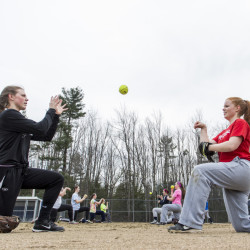 Yarmouth seniors Colleen Sullivan and Mari Cooper work on a throwing drill during a preseason practice. Both helped the Clippers win their first state title last spring.