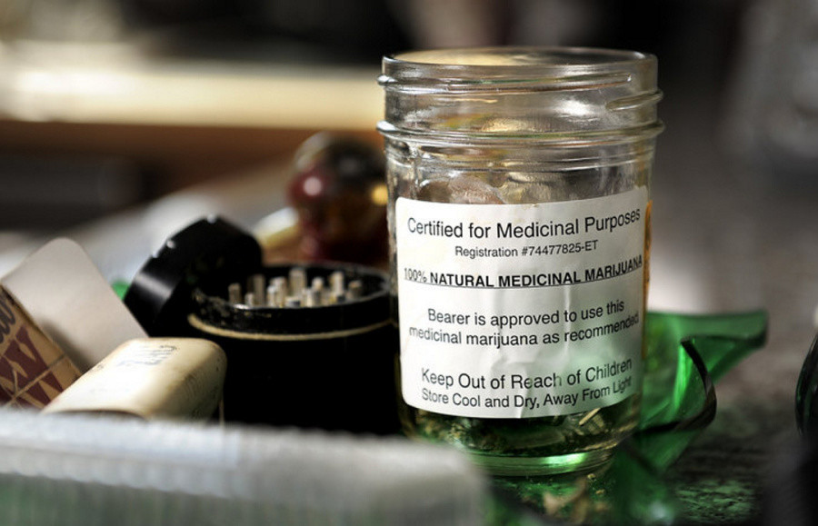 "A jar of cannabis labeled ""Certified for Medical Purposes"" is seen in the home of patients Catherine and Glenn Lewis of Manchester, who use it to treat the recurring effects of a car crash. Lack of extensive clinical evidence keeps many Maine doctors from certifying patients to use medical cannabis."