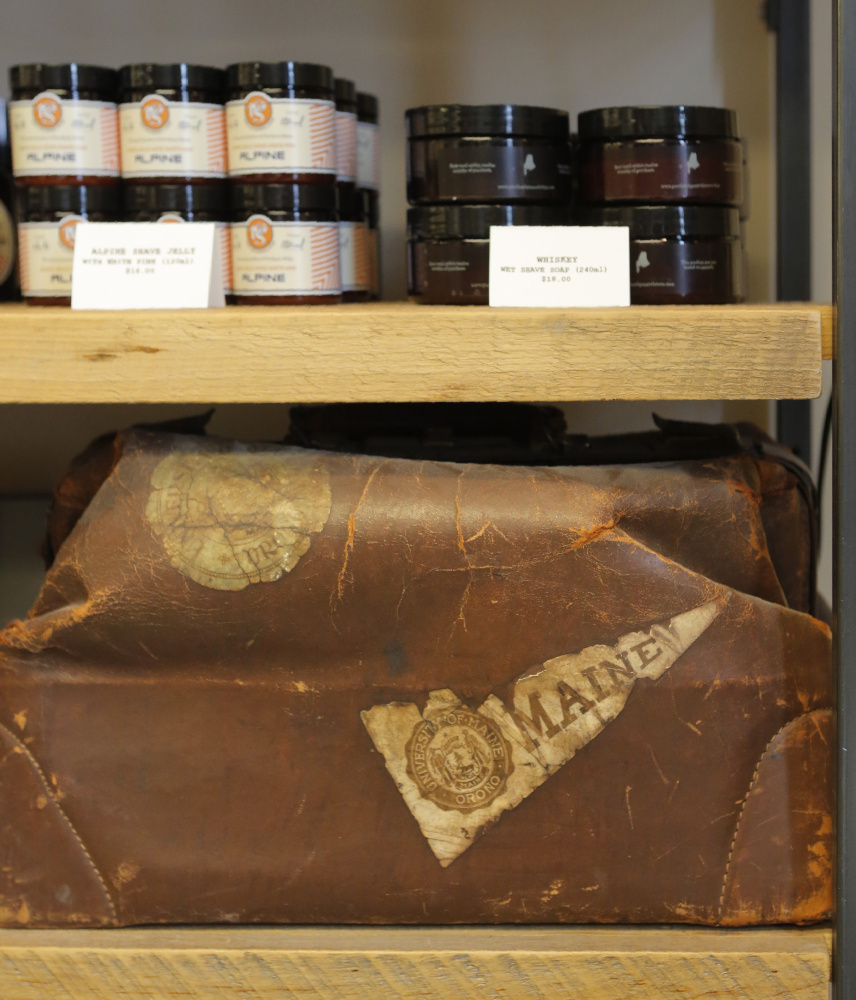 An old leather bag with a Maine banner on it at Portland General Store.