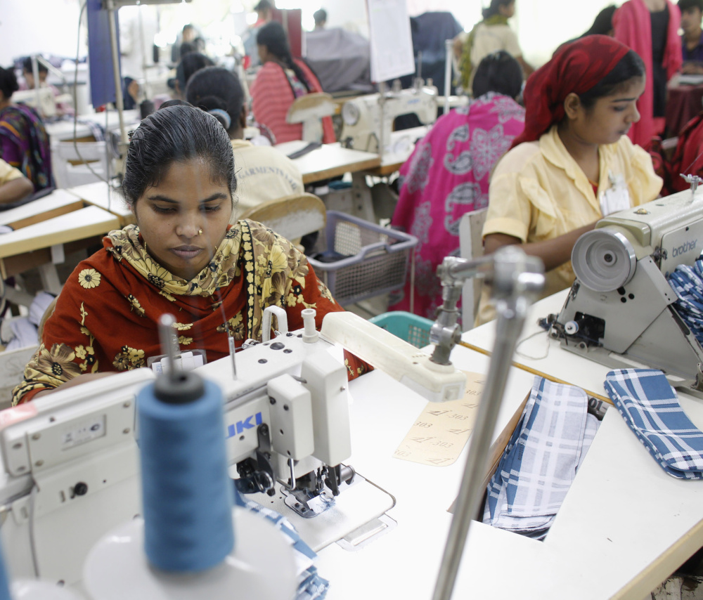 Employees work in a factory of Babylon Garments on the outskirts of Dhaka, the capital of Bangladesh, in January 2014.