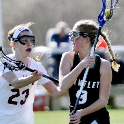 Nina Moore of Waynflete, right, drives with the ball as Eleanor Roberts of Cape Elizabeth defends Thursday in their girls' lacrosse game on the opening day of spring sports in Maine. Waynflete won 8-7 in overtime.
