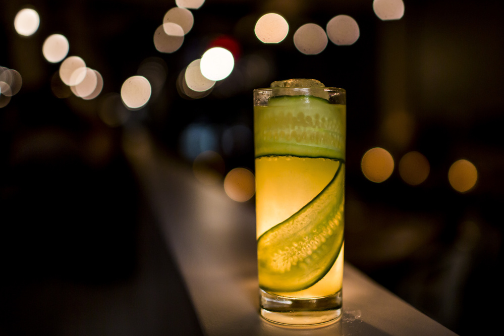 The Salato Highball features house-infused spicy tequila, Strega, lime juice and a cucumber garnish.
