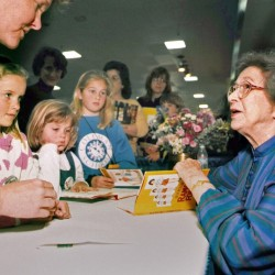 In this April 19, 1998, photo, Beverly Cleary signs books at the Monterey Bay Book Festival in Monterey, Calif. Even as she turns 100, the feisty and witty author remembers the Oregon childhood that inspired the likes of characters Ramona and Beezus Quimby and Henry Huggins in the children's books that sold millions and enthralled generations of youngsters.  The Associated Press