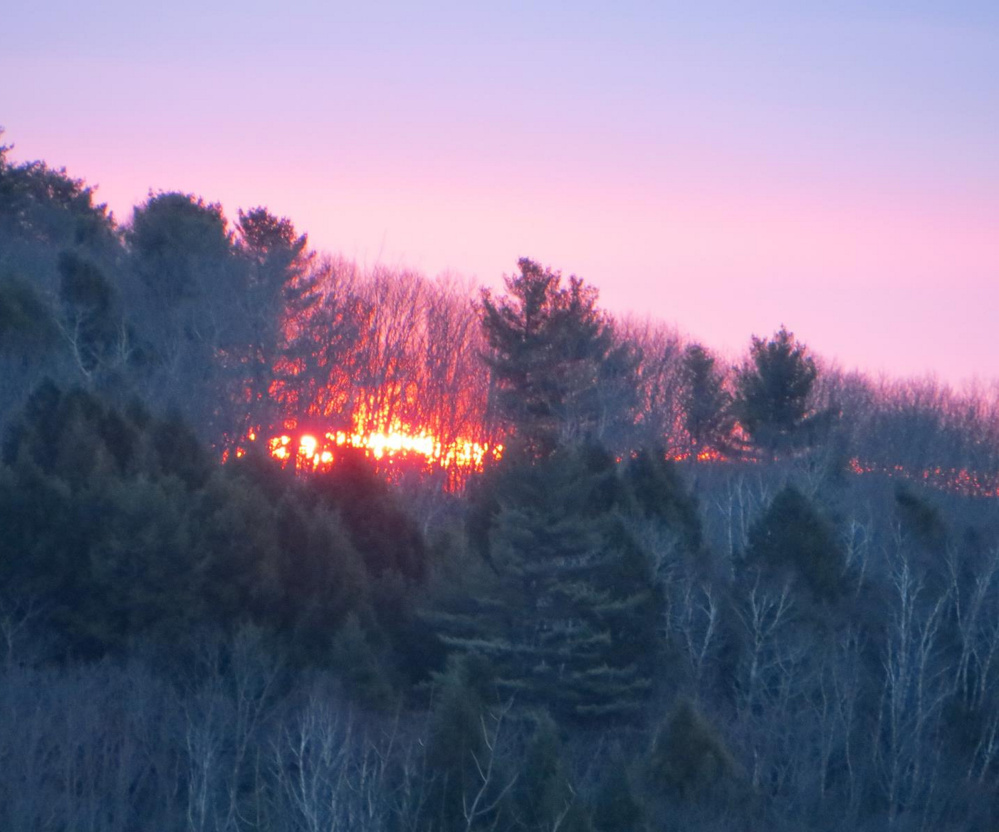 Looking like a forest fire, it's actually a sunrise as seen through the trees at Frye Mountain, taken from Richard Storey's home in Montville. But with windy, dry conditions in Maine, there's indeed a higher risk of brush and forest fires.