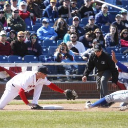 Jantzen Witte of the Portland Sea Dogs reaches to tag out Michael Benjamin of Hartford, who was attempting to steal third base in seventh inning during Saturday's game at Hadlock Field. Hartford won the game, 6-2.