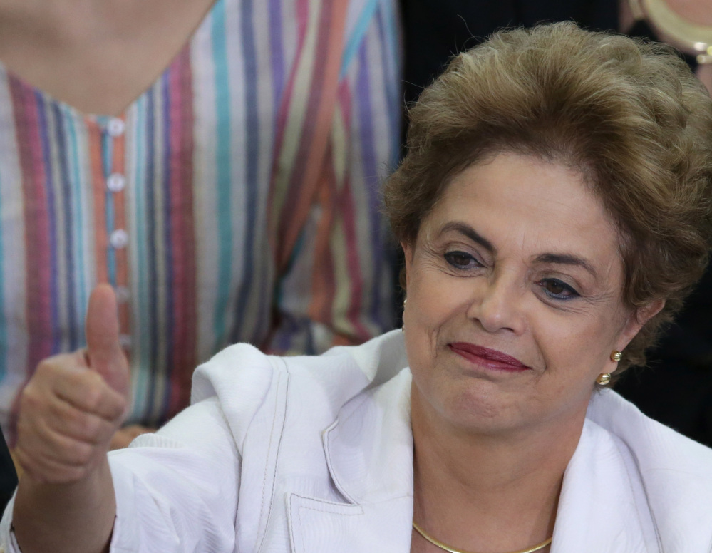 Brazil's President Dilma Rousseff gives a thumbs-up during an event at the presidential palace in Brasilia.