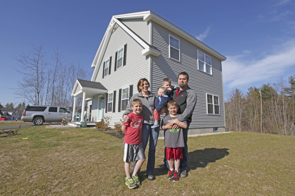 Dustin and Stacia Roma and their four boys – Braedon, 8, Blake, 7, Bentley, 4, and 1-year-old Bryson – have moved into a brand new home in the Sebago Heights subdivision in Windham, near the Raymond town line. The Romas wanted new construction in a neighborhood where their children could play.
