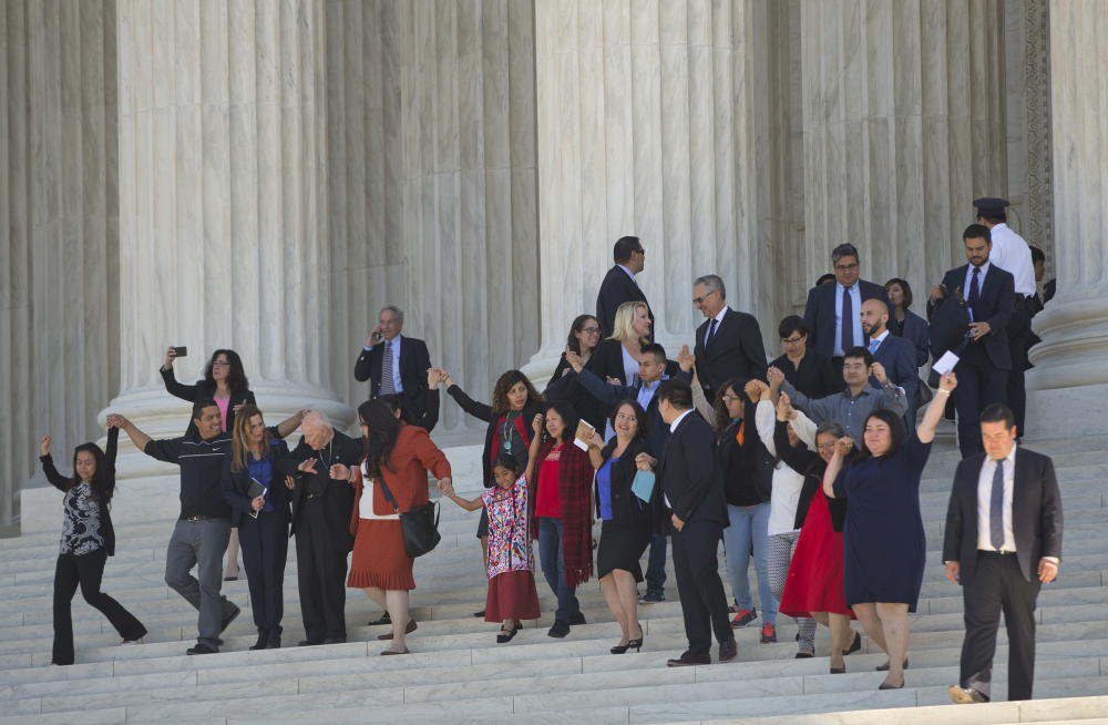 Supporters of immigration reform leave after hearing arguments at the Supreme Court in the case U.S. versus Texas Monday. The Supreme Court is taking up an important dispute over immigration that could affect millions of people.
