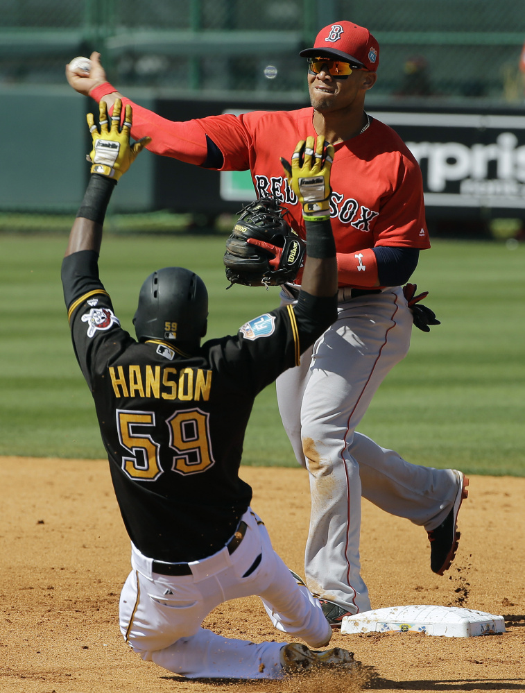 Boston Red Sox second baseman Yoan Moncada forces Pittsburgh Pirates' Alen Hanson (59) at second base and relays the throws to first in time to turn a double play on Francisco Cervelli during the fifth inning of a spring training baseball game Wednesday, March 9, 2016, in Bradenton, Fla. (AP Photo/Chris O'Meara)