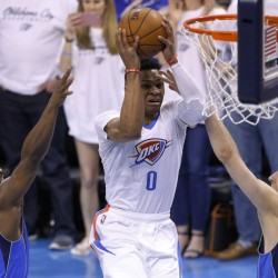 Oklahoma City's Russell Westbrook splits the Dallas defense of Raymond Felton, left, and Dirk Nowitzki during an 85-84 win by the Mavericks in Game 2 of their first-round playoff series Monday at Oklahoma City.