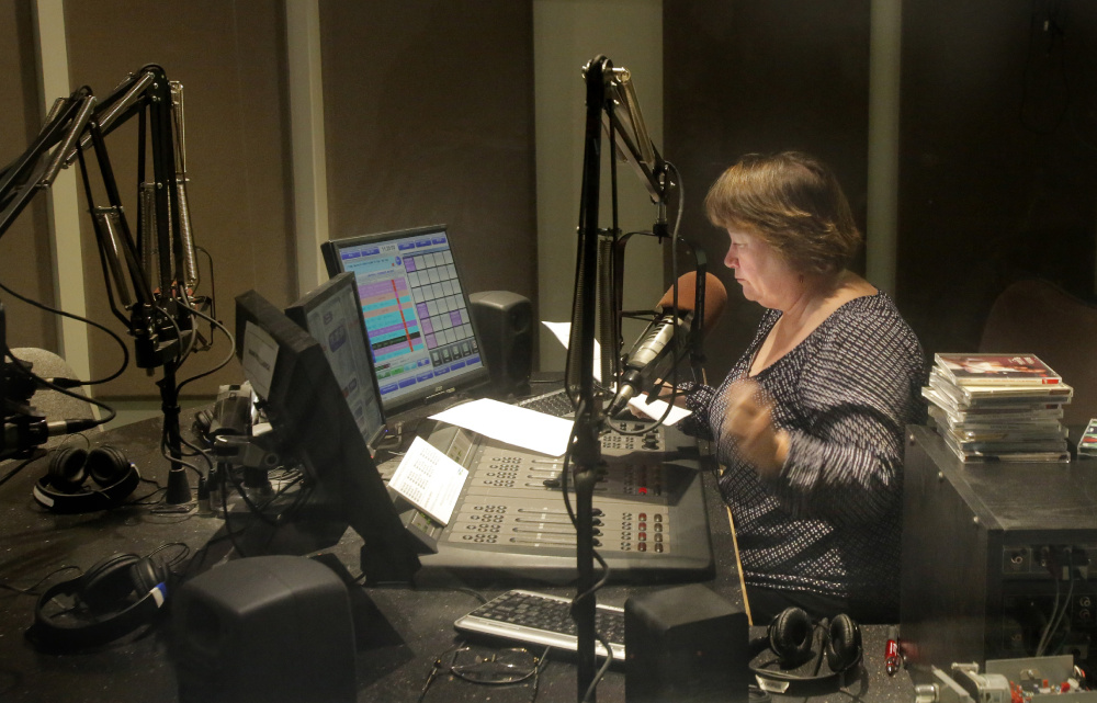 Robin Rilette hosts her morning classical music program in the Portland studios of the Maine Public Broadcasting Network on Tuesday. Starting May 9, her show will be carried on MPBN's new 24-hour classical music service, called Maine Public Classical, which will be available on stations in Waterville, Bangor and Fryeburg, as well as online and on HD radios. Gregory Rec/Staff Photographer