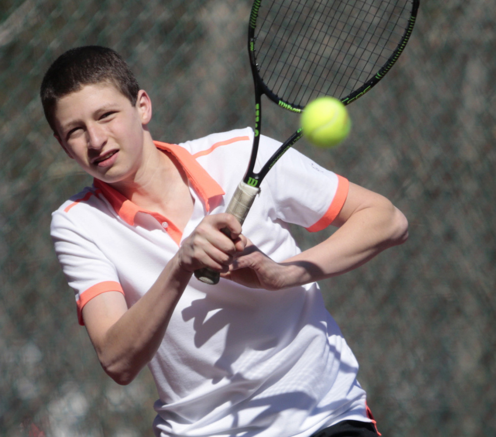 Nick Forester of Falmouth uses his right forehand during practice. Thing is, he's also adept with his left hand.