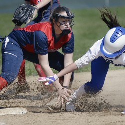 Third baseman Grace Kariotis blocks the bag and tags out Malori Cole of Kennebunk during their Western Maine Conference softball game Wednesday. Gray-New Gloucester won, 15-5.