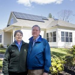 OceanView at Falmouth retirement community employs the use of solar panels and other environmentally friendly features. Bill and Margot Gatchell pose for a portrait in front of their home at OceanView.