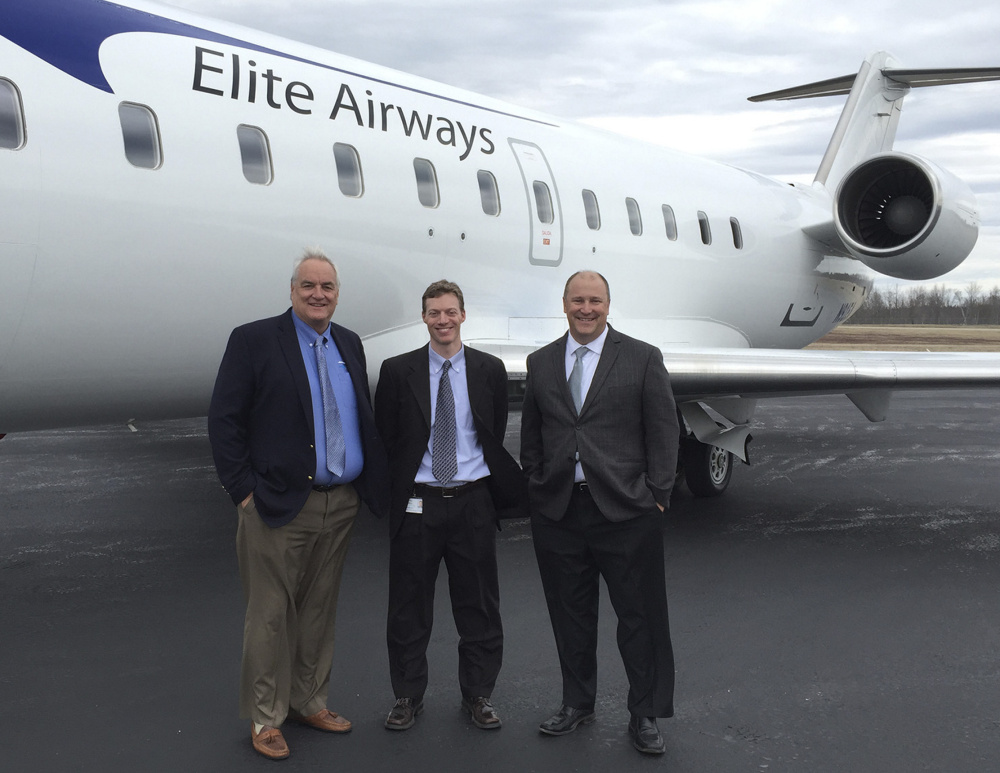 John Pearsall, left, president of Elite Airways, is joined by Brad Madeira, Hancock County-Bar Harbor Airport director, and Dave Dow, vice president of sales at Elite Airways.