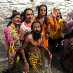 Transgender activists take a dip in the holy waters of the Shipra River at a Hindu festival in Ujjain, India, on Friday. A landmark 2014 Supreme Court ruling recognized a third gender.