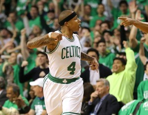 Boston Celtics guard Isaiah Thomas reacts to hitting a 3-pointer against the Atlanta Hawks during the first half of Game 3 of an NBA basketball first-round playoff series Friday, April 22, 2016, in Boston. (Curtis Compton/Atlanta Journal Constitution via AP)