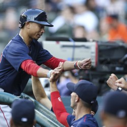 Red Sox right fielder Mookie Betts celebrates with teammates after scoring in the first inning at Houston on Friday night. Betts had tripled to start the game, and finished with two triples, a double and a single.