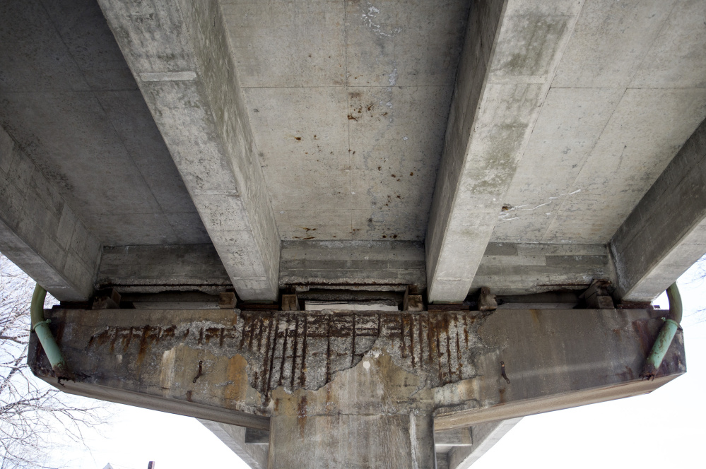 Corrosion was visible under the supports for the Bath viaduct in  2016, before the replacement project began. At the time, the Maine Department of Transportation said the bridge was safe, but added wooden blocks to reinforce the support.