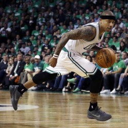 Celtics guard Isaiah Thomas dribbles the ball against the Atlanta Hawks during the third quarter in Game 3 of a first-round NBA playoff series Friday in Boston. The Celtics won 111-103. Thomas finished with a career-high 42 points.  The Associated Press