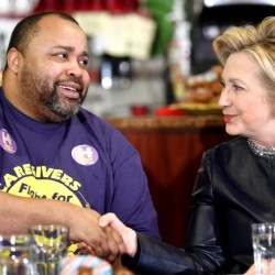 Terrell Williams shakes hands with Democratic presidential candidate Hillary Clinton during a campaign stop at Orangeside on Temple in New Haven, Conn., on Saturday.