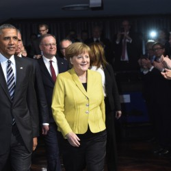 President Obama and German Chancellor Angela Merkel arrive for the opening of the Hannover Messe industry fair in Hannover, northern Germany, on Sunday.