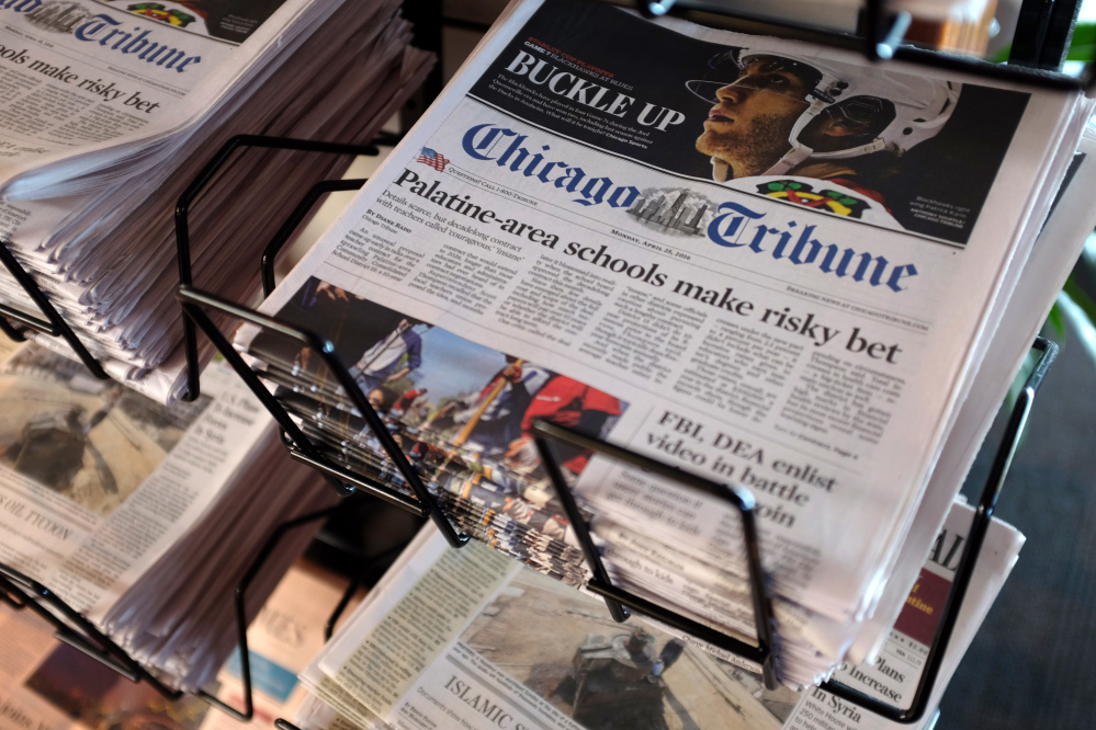 Chicago Tribune and other newspapers are displayed at Chicago's O'Hare International Airport on Monday.