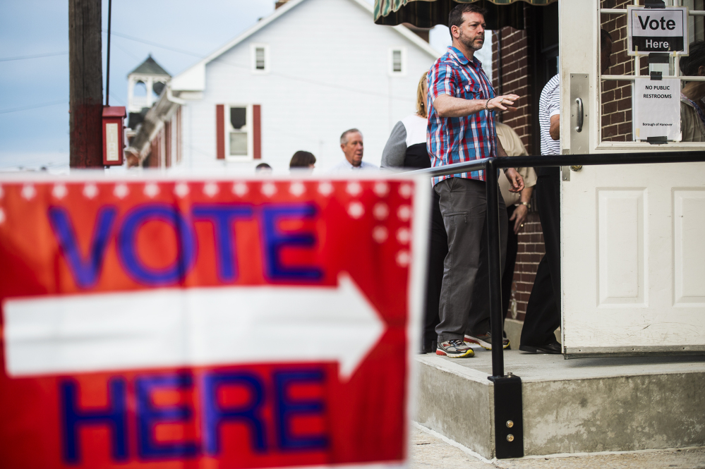 Voters line up to enter at the Hanover Market House polling station in the 2nd ward Tuesday in Hanover, Pa., borough. Although Pennsylvania has the largest number of delegates up for grabs Tuesday, it's more of a wild card than the other states.