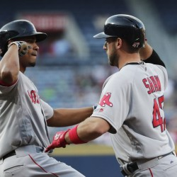 Boston's Travis Shaw, right, high-fives teammate Xander Bogaerts after hitting a three-run home run in the first inning of Tuesday's game against the Atlanta Braves. (Photos by The Associated Press)