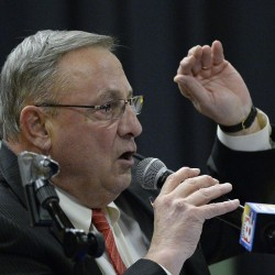 Gov. Paul LePage speaks at Thursday night's town hall meeting in Damariscotta. He urged people in the audience to vote against a statewide ballot measure to raise Maine's minimum wage to $12 an hour.