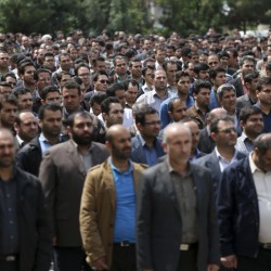 In this picture made available by Young Journalists Club, YJC, on Monday, April 18, 2016, Iranian plainclothes police officers stand in an inauguration ceremony of a newly established undercover division of the morality police, at the Tehran police department, Iran. Tehran police chief Gen. Hossein Sajedinia recently announced his department had deployed 7,000 male and female officers for a new plainclothes division _ the largest such undercover assignment in memory. (AP Photo/YJC, Mohammad Ali Najib)