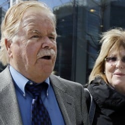 "Robert Fitzpatrick walks from federal court in Boston April 30, 2015, with his wife, Jane. At that time, Fitzpatrick pleaded not guilty to charges of perjury during James ""Whitey"" Bulger's trial but he is expected to change his plea."
