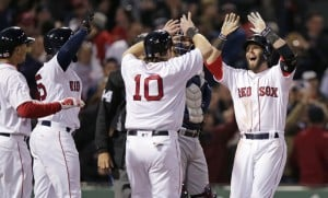 Boston's Dustin Pedroia, right, is congratulated after his grand slam in the second inning Wednesday night at Fenway Park.