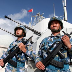 Chinese soldiers stand guard in the Spratly Islands, known in China as the Nansha Islands, on February 10. .China has built shoals into outposts.