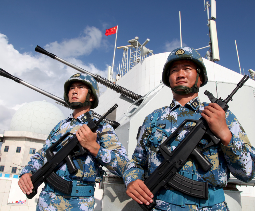 Chinese soldiers stand guard in the Spratly Islands, known in China as the Nansha Islands, on Feb 10. China has built military outposts on the disputed group of 14 islands, islets and more than 100 reefs in the South China Sea.