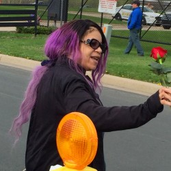 Prince's sister, Tyka Nelson, holds a rose outside Paisley Park, the home of her brother, in Chanhassen, Minn., last week. Nelson went out to thank fans who gathered at the home to mourn the loss of the pop star who died April 21.