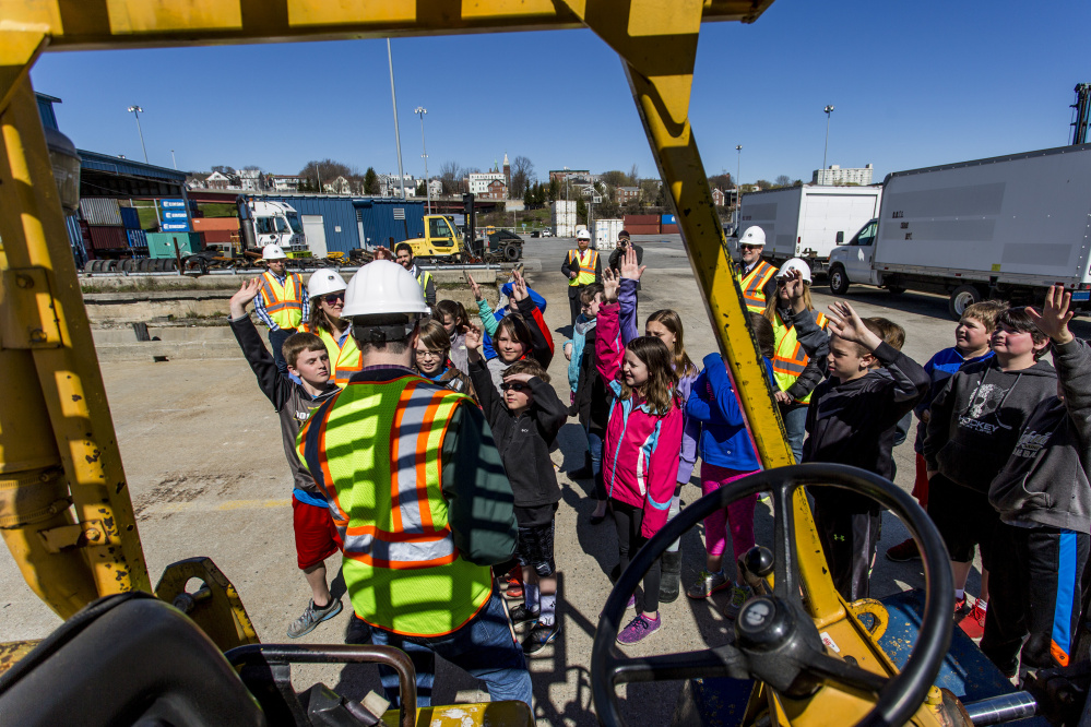 David Arnold of the Maine Port Authority leads students from Dyer Elementary School in South Portland on a tour of the International Marine Terminal in Portland on Thursday morning.